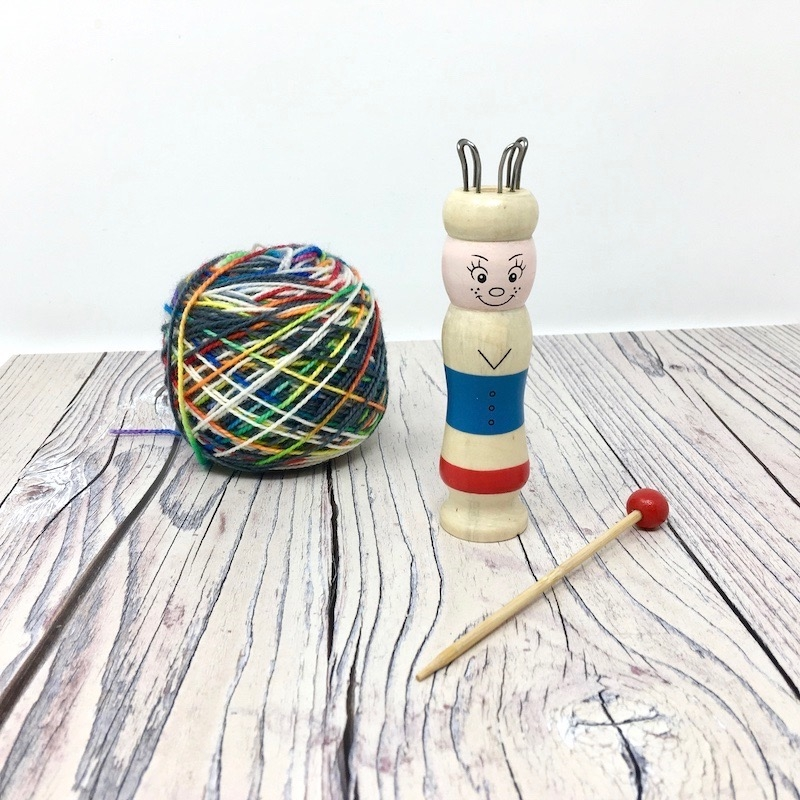 Knitting Nancy with ball of wool